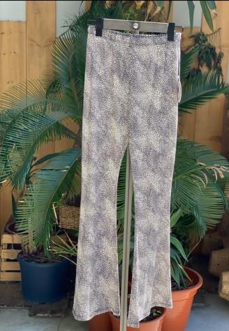 Pantalón de licra con estampado print animal